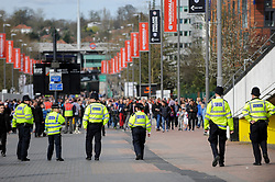 © Licensed to London News Pictures. 26/03/2017. London, UK. Policemen and policewomen are seen on Wembley Way.  Following the Westminster terrorist attack, a visible security presence is on display outside Wembley Stadium for the World Cup qualifier match between England and Lithuania.  Photo credit : Stephen Chung/LNP