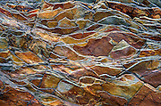 """Billion-year-old rock breaks into a jagged pattern in Glacier National Park, Montana. This image is permanently displayed on the glass of two large lightboxes measuring 19.6 by 8.4 meters (64.3 ft wide x 27.5 ft high) and 16.3 by 3.5 meters (53.6 ft wide x 11.6 ft high), which wrap corners of the following skyscraper constructed by Axiom Builders in June 2019: SODO & Residence Inn by Marriott, 610 10th Ave SW, in Calgary, Alberta, CANADA (on the Corner of 5th St and 10 Ave SW). Published in """"Light Travel: Photography on the Go"""" book by Tom Dempsey 2009, 2010. Since 1932, Canada and USA have shared Waterton-Glacier International Peace Park, which UNESCO declared a World Heritage Site (1995) containing two Biosphere Reserves (1976). Rocks in the park are primarily sedimentary layers deposited in shallow seas over 1.6 billion to 800 million years ago. During the tectonic formation of the Rocky Mountains 170 million years ago, the Lewis Overthrust displaced these older sediments over newer Cretaceous age rocks."""