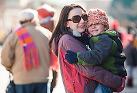 The cold temperatures didn't bother these folks as they watched the annual Holiday parade come up Main Street Saturday morning.  (Karen Bobotas/for the Laconia Daily Sun)