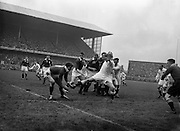 Irish Rugby Football Union, Ireland v England, Five Nations, Landsdowne Road, Dublin, Ireland, Saturday 9th February, 1957,.9.2.1957, 2.9.1957,..Referee- A I Dickie, Scottish Rugby Union, ..Score- Ireland 0 - 6 England, ..Irish Team, ..P J Berkery, Wearing number 15 Irish jersey, Full back, Landsdowne Rugby Football Club, Dublin, Ireland,..A J O'Reilly, Wearing number 14 Irish jersey, Right wing, Old Belvedere Rugby Football Club, Dublin, Ireland,  ..N J Henderson, Wearing number 13 Irish jersey, Captain of the Irish team, Right centre, N.I.F.C, Rugby Football Club, Belfast, Northern Ireland, ..A C Pedlow, Wearing number 12 Irish jersey, Left centre, Queens University Rugby Football Club, Belfast, Northern Ireland,..N H Brophy, Wearing number 11 Irish jersey, Left wing, University College Dublin Rugby Football Club, Dublin, Ireland, ..J W Kyle, Wearing number 10 Irish jersey, Ouside Half, N.I.F.C, Rugby Football Club, Belfast, Northern Ireland, ..A A Mulligan, Wearing Number 9 Irish Jersey, Scrum half, London Irish Rugby Football Club, Surrey, England, and, Cambridge University Rugby Football Club, Cambridge, England, ..P J O'Donoghue, Wearing  Number 1 Irish jersey, Forward, Bective Rangers Rugby Football Club, Dublin, Ireland,..R Roe, Wearing number 2 Irish jersey, Forward, London Irish Rugby Football Club, Surrey, England, ..B G Wood, Wearing number 3 Irish jersey, Forward, Garryowen Rugby Football Club, Limerick, Ireland, ..T E Reid, Wearing number 4 Irish jersey, Forward, Garryowen Rugby Football Club, Limerick, Ireland, and, London Irish Rugby Football Club, Surrey, England, ..J R Brady, Wearing number 5 Irish jersey, Forward, C I Y M S Rugby Football Club, Belfast, Northern Ireland, ..H S O'Connor, Wearing number 6 Irish jersey, Forward, Dublin University Rugby Football Club, Dublin, Ireland,..P J A O'Sullivan, Wearing  Number 7 Irish jersey, Forward, Galwegians Rugby Football Club, Galway, Ireland,...J R Kavanagh, Wearing number 8 Irish jersey, Forward, Wand