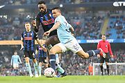 33 Gabriel Jesus for Manchester City crosses challenged by Rotherham United defender Semi Ajayi (5) during the The FA Cup 3rd round match between Manchester City and Rotherham United at the Etihad Stadium, Manchester, England on 6 January 2019.