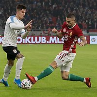 Brian Rodriguez (L) of Uruguay and Zsolt Nagy (R) of Hungary fight for the ball during the Inauguration match of the newly reconstructed Ferenc Puskas Stadium between Hungary and Uruguay in Budapest, Hungary on Nov. 15, 2019. ATTILA VOLGYI