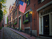 """Beacon Hill is a historic neighborhood of Boston, Massachusetts, that along with the neighboring Back Bay is home to about 26,000 people.[3] It is a neighborhood of Federal-style rowhouses and is known for its narrow, gas-lit streets and brick sidewalks. Today, Beacon Hill is regarded as one of the most desirable and expensive neighborhoods in Boston.[4]<br /> <br /> The Beacon Hill area is located just north of Boston Common and the Boston Public Garden and is bounded generally by Beacon Street on the south, Somerset Street on the east, Cambridge Street to the north and Storrow Drive along the riverfront of the Charles River Esplanade to the west. The block bounded by Beacon, Tremont and Park Streets is included as well, as is the Boston Common itself. The level section of the neighborhood west of Charles Street, on landfill, is known locally as the """"Flat of the Hill."""""""