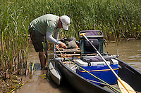 angler and guide Drew Price rigs up the canoe for a day of fishing on lake champlain
