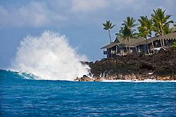 Unusual high surf in leeward, Kona, crashing on lava rocks and thrreatening luxury condominiums behind, Keauhou Bay, Kona Coast, Big Island, Hawaii, Pacific Ocean.