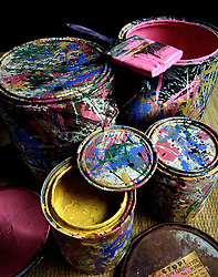 Abstract design splattered paint cans. multi color colour colorful yellow red blue green purple streaks blotches splotches CONCEPT STOCK PHOTOS