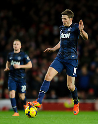 Man Utd Midfielder Michael Carrick (ENG) in action - Photo mandatory by-line: Rogan Thomson/JMP - 07966 386802 - 12/02/14 - SPORT - FOOTBALL - Emirates Stadium, London - Arsenal v Manchester United - Barclays Premier League.