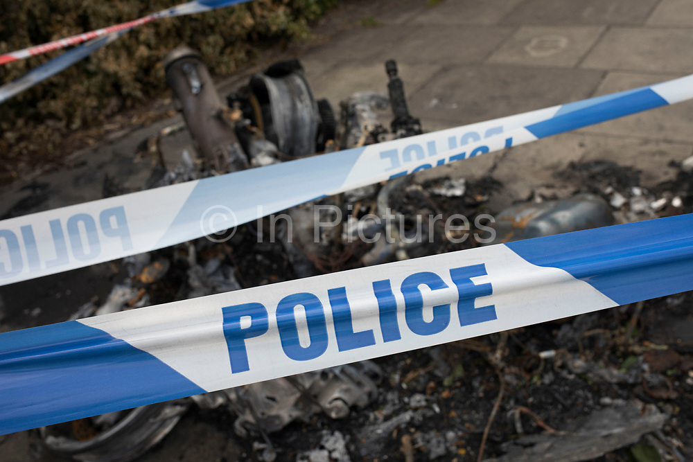 The remains of a burnt out motor scooter in London, England, United Kingdom. Crime involving scooters and mopeds has increased in London, but this crime wave is yet to spread further into the UK.