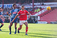 Jacob Brown of Barnsley (33) and Sido Jombati of Wycombe Wanderers (2) watch the loose ball in the area during the EFL Sky Bet League 1 match between Barnsley and Wycombe Wanderers at Oakwell, Barnsley, England on 16 February 2019.