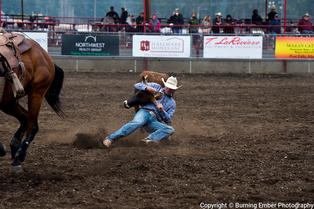 Guy Smith in the Steer Wrestling event at the Gem State Stampede August 26th, 2018 slack in Couer D'Alene ID.  Photo by Josh Homer/Burning Ember Photography.  Photo credit must be given on all uses.
