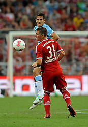 01.08.2013, Allianz Arena, Muenchen, Audi Cup 2013, FC Bayern Muenchen vs Manchester City, im Bild, Vorne Bastian SCHWEINSTEIGER (FC Bayern Muenchen), hinten Stevan JOVETIC (Manchester City) // during the Audi Cup 2013 match between FC Bayern Muenchen and Manchester City at the Allianz Arena, Munich, Germany on 2013/08/01. EXPA Pictures © 2013, PhotoCredit: EXPA/ Eibner/ Wolfgang Stuetzle<br /> <br /> ***** ATTENTION - OUT OF GER *****