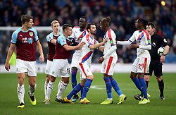 Burnley's Ashley Westwood and Crystal Palace's Wilfried Zaha (second right) are kept apart by their team-mates during the Premier League match at Turf Moor, Burnley.