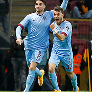 Trabzonspor's Carl Medjani (L) celebrate his goal with team mate during their Turkish superleague soccer derby match Galatasaray between Trabzonspor at the AliSamiYen spor kompleksi TT Arena in Istanbul Turkey on Saturday, 22 November 2014. Photo by Aykut AKICI/TURKPIX
