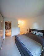 Elegant bedroom with bathroom. Nobody inside