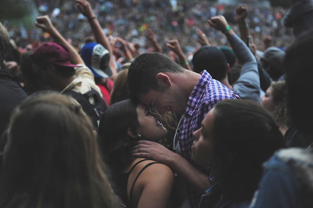 Isaac Maycock and Petra de Matran embrace during Atmoshpere's performance on Sutro stage at Outside Lands Music Festival in Golden Gate Park on August 09, 2014 in San Francisco, CA.