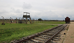 A Deutsche Reichsbahn 'Gueterwagen' (goods wagon), one type of rail car used for deportations, next to a guard tower, at the Auschwitz-Birkenau Nazi concentration camps in Auschwitz, Poland on September 3, 2017. Auschwitz concentration camp was a network of German Nazi concentration camps and extermination camps built and operated by the Third Reich in Polish areas annexed by Nazi Germany during WWII. It consisted of Auschwitz I (the original camp), Auschwitz II–Birkenau (a combination concentration/extermination camp), Auschwitz II–Monowitz (a labor camp to staff an IG Farben factory), and 45 satellite camps. In September 1941, Auschwitz II–Birkenau went on to become a major site of the Nazi Final Solution to the Jewish Question. From early 1942 until late 1944, transport trains delivered Jews to the camp's gas chambers from all over German-occupied Europe, where they were killed en masse with the pesticide Zyklon B. An estimated 1.3 million people were sent to the camp, of whom at least 1.1million died. Around 90 percent of those killed were Jewish; approximately 1 in 6 Jews killed in the Holocaust died at the camp. Others deported to Auschwitz included 150,000 Poles, 23,000 Romani and Sinti, 15,000 Soviet prisoners of war, 400 Jehovah's Witnesses, and tens of thousands of others of diverse nationalities, including an unknown number of homosexuals. Many of those not killed in the gas chambers died of starvation, forced labor, infectious diseases, individual executions, and medical experiments. In 1947, Poland founded a museum on the site of Auschwitz I and II, and in 1979, it was named a UNESCO World Heritage Site. Photo by Somer/ABACAPRESS.COM