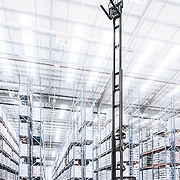 A very high reach forklift truck photographed in an industrial warehouse showing the impressive reach of a Linde logistics truck.