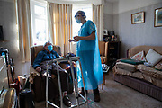 Dr Fordham of the Channel Health Alliance chats to a patient after giving the AstraZeneca COVID-19 vaccination to a housebound patient at their home in the community outside Dover on the 27th of February 2021, Dover, Kent, United Kingdom.