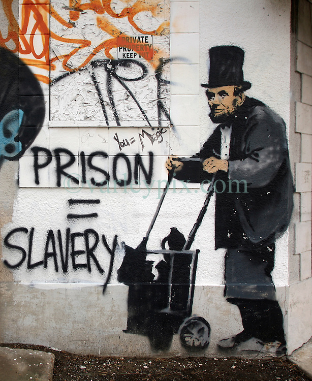 31 May 2010. New Orleans, Louisiana, USA.  <br /> Banksy street graffiti of Lincoln as a homeless vagrant in downtown New Orleans. The building has since been demolished. It is unknown if any part of the wall was saved? Banksy visited New Orleans in 2008.<br /> Photo; Charlie Varley.