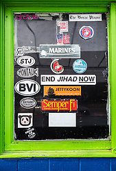 stickers on a window in Montauk, NY