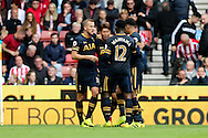 Son Heung-Min (c) of Tottenham Hotspur celebrates with his teammates after scoring his teams 1st goal. Premier league match, Stoke City v Tottenham Hotspur at the Bet365 Stadium in Stoke on Trent, Staffs on Saturday 10th September 2016.<br /> pic by Chris Stading, Andrew Orchard sports photography.