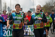 """A couple carring the baton run on the 20th Korrika. Irun (Basque Country). April 4, 2017. The """"Korrika"""" is a relay course, with a wooden baton that passes from hand to hand without interruption, organised every two years in a bid to promote the basque language. The Korrika runs over 11 days and 10 nights, crossing many Basque villages and cities. This year was the 20th edition and run more than 2500 Kilometres. Some people consider it an honour to carry the baton with the symbol of the Basques, """"buying"""" kilometres to support Basque language teaching. (Gari Garaialde / Bostok Photo)"""