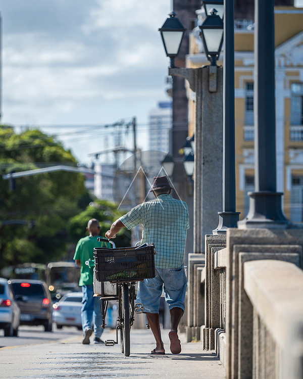 Recife, Brazil - 21 January 2019: View of a person with a bicycle in Recife downtown, Brazil.