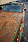 an old very rusty big American car