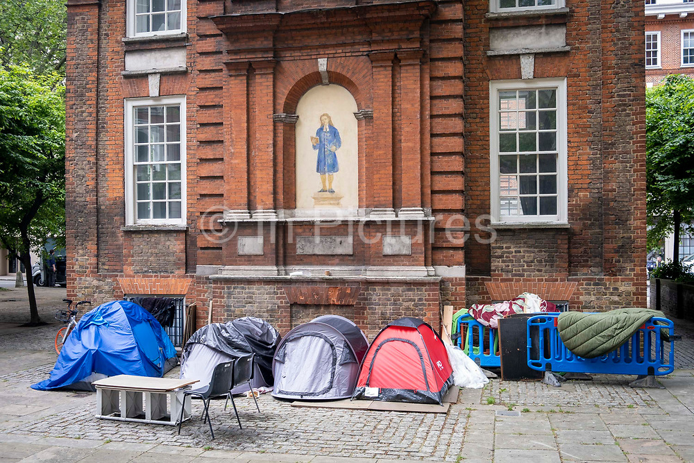 Tents belonging to people living on the street in London camped out behind the old Blewcoat School building for the poor on the corner of Caxton Street and Buckingham gate on the 25th of May 2021 in Westminster, Central London. The Blewcoat school building was built in 1709 as a school for the poor which was used until 1926. The property is now owned by the Nation Trust.