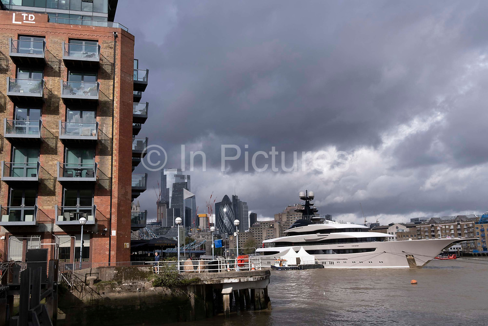 The superyacht Kismet is moored opposite Butlers Wharf, downstream on the river Thames from Tower Bridge and the capitals financial districts skyscrapers, on 20th October 2021, in London, England. Kismet is a 95.2m 312 ft-long superyacht which was built in 2014. It is managed by the Moran Yacht & Ship chartering business, and is owned by Pakistani-American billionaire Shahid Khan. Kismet means destiny or fate in Khan's native Urdu.
