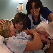 Jen, with Jane by her side delivers a baby girl, Luca in a hospital in Sydney, Australia, on 21st January 2009. Photo by Tim Clayton.