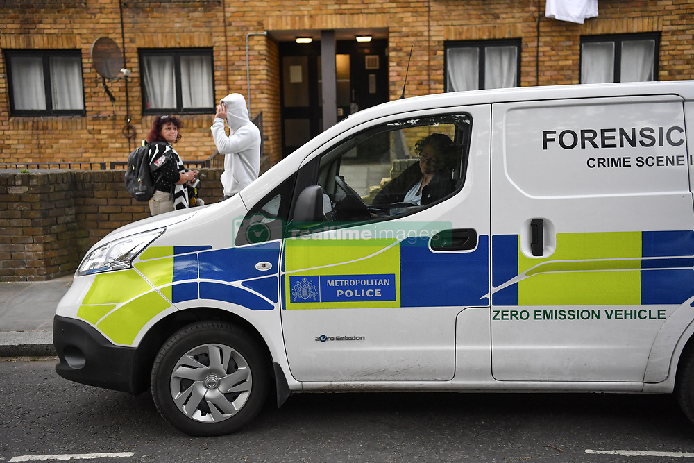 May 1, 2019 - London, London, United Kingdom - London, UK.  A police forensics vehicle outside a flat on St Evans Road, Westbourne Park. The property is understood to belong to a 34yr old man who was arrested yesterday in connection with the double murder in Canning Town where the bodies of two women were found in chest Freezer. The Investigation is ongoing. (Credit Image: © Guilhem Baker/London News Pictures via ZUMA Wire)