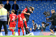 Jurgen Klopp, the Liverpool manager hugs Adam Lallana of Liverpool after the final whistle.Premier league match, Chelsea v Liverpool at Stamford Bridge in London on Friday 16th September 2016.<br /> pic by John Patrick Fletcher, Andrew Orchard sports photography.