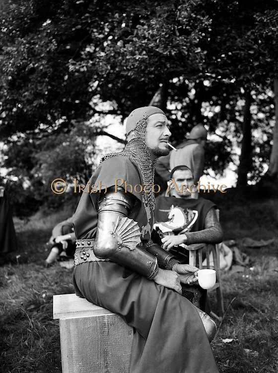 Film - 'The Knights of the Round Table' at Luttrellstown Castle, Castleknock, Co. Dublin.Robert Taylor on set. Stanley Baker (in back).25/08/1953  ..Knights of the Round Table is a 1953 Technicolor Cinemascope historical film made by MGM. Directed by Richard Thorpe and produced by Pandro S. Berman, it was the first film in Cinemascope made by that studio. The screenplay was by Talbot Jennings, Jan Lustig and Noel Langley from the book Le Morte d'Arthur by Sir Thomas Malory..The film was the second in an unofficial trilogy made by the same director and producer and starring Robert Taylor, coming between Ivanhoe (1952) and The Adventures of Quentin Durward (1955). All three were made at MGM's British Studios at Elstree, near London and partly filmed on location. The cast included Robert Taylor as Sir Lancelot, Ava Gardner as Queen Guinevere, Mel Ferrer as King Arthur, Stanley Baker as Mordred, Anne Crawford as Morgan Le Fay, Felix Aylmer as Merlin..