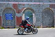 Motorcyclist on MV Agusta Brutale motorbike drives The Stelvio Pass, Passo dello Stelvio, Stilfser Joch, to Bormio, Italy