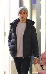Manchester United'™s Ander Herrera and family head into Manchester city centre on Thursday evening to do some last minute Christmas shopping