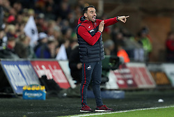 """Swansea City caretaker manager Leon Britton during the Premier League match at the Liberty Stadium, Swansea. PRESS ASSOCIATION Photo. Picture date: Saturday December 23, 2017. See PA story SOCCER Swansea. Photo credit should read: David Davies/PA Wire. RESTRICTIONS: EDITORIAL USE ONLY No use with unauthorised audio, video, data, fixture lists, club/league logos or """"live"""" services. Online in-match use limited to 75 images, no video emulation. No use in betting, games or single club/league/player publications."""
