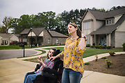 "PELHAM, AL – MARCH 30, 2020: Susan Lee, 43, spends time with her 12 year-old daughter, Alyssa, outside their home in the Keenland Valley neighborhood. As a special education teacher with 23 years of experience in Shelby County schools, Lee has found it challenging to establish a rhythm at home with her own special needs child, in the midst of school closures due to coronavirus. ""It obviously makes things hard,"" Lee said. ""As teachers, we want what's best for our students. And as parents we want the same, but we can't provide that right now."" Lee's daughter was born with RETT syndrome – a genetic neurological disorder that impairs most basic functions. ""Like most kids with special needs, she likes a routine,"" Lee said. ""So it's stressful. It's required a lot of thinking outside the box. But the kids are stressed too. In their undeveloped brains, they're struggling more than we think they are."""