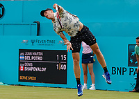 Tennis - 2019 Queen's Club Fever-Tree Championships - Day Three, Wednesday<br /> <br /> Men's Singles, First Round: Juan Martin Del Potro (ARG) Vs. Denis Shapovalov (CAN)<br /> <br /> Denis Shapovalov (CAN) with the follow through after serving on Centre Court.<br />  <br /> COLORSPORT/DANIEL BEARHAM