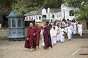 Monks at Dambulla cave Buddhist temple complex, Sri Lanka, Asia