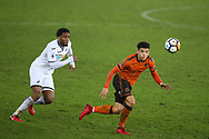 Morgan Gibbs-White of Wolverhampton Wanderers in action with Leroy Fer of Swansea city (l).  the Emirates FA Cup, 3rd round replay match, Swansea city v Wolverhampton Wanderers at the Liberty Stadium in Swansea, South Wales on Wednesday 17th January 2018.<br /> pic by  Andrew Orchard, Andrew Orchard sports photography.
