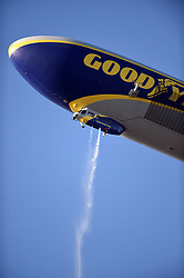 March 29, 2018 - Los Angeles, CA, U.S. - LOS ANGELES, CA - MARCH 29: The Goodyear blimp releases a liquid over the outside of the stadium during the MLB opening day game between the San Francisco Giants and the Los Angeles Dodgers on March 29, 2018 at Dodger Stadium in Los Angeles, CA. (Photo by Chris Williams/Icon Sportswire) (Credit Image: © Chris Williams/Icon SMI via ZUMA Press)