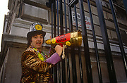 Screaming Lord Sutch holds up a megaphone to the gates of Downing Street in the run-up to the 1992 elections, on 11th March, in London UK. David Edward Sutch 10 November 1940 – 16 June 1999, also known as 3rd Earl of Harrow, or simply Screaming Lord Sutch, was an English musician. He was the founder of the Official Monster Raving Loony Party and served as its leader from 1983 to 1999, during which time he stood in numerous parliamentary elections. He holds the record for losing more than 40 elections in which he stood. Suffering from depression he committed suicide 1999.