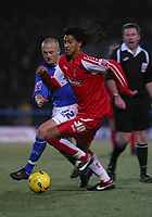 Photo: Dave Linney.<br />Chesterfield v Swindon Town. Coca Cola League 1.<br />28/12/2005.Ashan Holgate(Swindon) beats    Sammy Clingan(Chesterfield) to the ball.