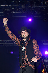 Sergio Pizzorno of Kasabian on stage at the Isle of Skye festival, 2007..Pic ©2010 Michael Schofield. All Rights Reserved..