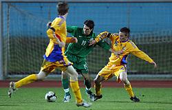 Luka Majcen (19)  of Slovenia vs Vasilie Buhaescu of Romania  during Friendly match between U-21 National teams of Slovenia and Romania, on February 11, 2009, in Nova Gorica, Slovenia. (Photo by Vid Ponikvar / Sportida)