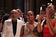 NEW YORK, NEW YORK-JUNE 4: (L-R) Visual Artist Radicliffe Bailey, Chef Leslie Parks Bailey and Author Liani Madhubuti watch as Jamel Shabazz makes his epic tribute to the 20th Anniversary of Gordon Parks' Great Day in Hip Hop during the 2019 Gordon Parks Foundation Awards Dinner and Auction Inside celebrating the Arts & Social Justice held at Cipriani 42nd Street on June 4, 2019 in New York City. (Photo by Terrence Jennings/terrencejennings.com)