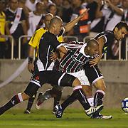 Fluminense striker Emerson is tackled by Nilton (left) and Fernando of Vasco during the Fluminense FC V CR Vasco da Gama Futebol Brasileirao League match at the Maracana, Jornalista Mário Filho Stadium, Rio de Janeiro,  Brazil. 22nd August 2010. Photo Tim Clayton.