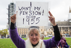 London, UK. 5 November, 2019. A campaigner from WASPI (Women Against State Pension Inequality) protests in Parliament Square to call for fair transitional pension arrangements for women born in the 1950s affected by the changes to the State Pension Age (SPA), including a 'bridging' pension to provide an income from age 60 until State Pension Age and recompense for losses incurred by women who have already reached their SPA.