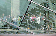 People are reflected in the glass of the of Atrium at SUNY New Paltz during the grand opening of the building on Monday, Sept. 13, 2010.